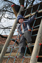 Child standing on rope ladder Royalty Free Stock Photography