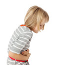 Child with stomach ache girl pain isolated on white Royalty Free Stock Photography