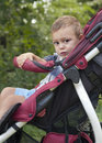 Child in stroller toddler sitting a or pushchair park Royalty Free Stock Photos