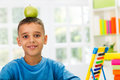 Child study and have apple in head playing with on worktable Stock Images