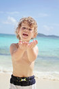 Child summer beach and ocean fun happy smiling on a tropical near having Royalty Free Stock Image