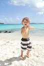 Child summer beach and ocean fun happy smiling on a tropical near having Stock Photography