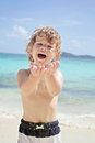 Child summer beach and ocean fun happy smiling on a tropical near having Stock Image