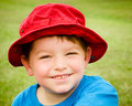 Child in summer portrait wearing bright red hat Royalty Free Stock Photography