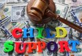 Child support letters with gavel and cash Stock Photo