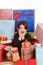 Child surprised with lots of christmas gifts Stock Images