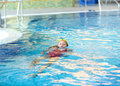 Child swimming backstroke pool Royalty Free Stock Image