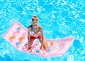 Child swimming on beach mattress inflatable Stock Photo