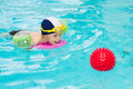 Child swimming pool, kid playing water ball, boy indoor training Royalty Free Stock Photo