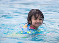 Child swimming in a pool enjoying Stock Photos
