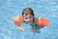 Child in swimming pool happy summer Stock Images