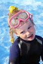 Child in swimming pool learning snorkeling. Stock Photos