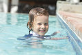 Child swimming in pool toddler boy an outdoor learning Stock Photography