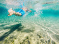 Child swimming seen from behind underwater Royalty Free Stock Photo