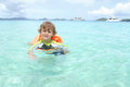 Child swimming in tropical ocean toddler a caribbean summer vacation Stock Photography