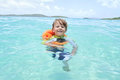 Child swimming in tropical ocean toddler a caribbean summer vacation Royalty Free Stock Image