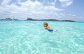 Child swimming in tropical ocean toddler a caribbean summer vacation Stock Images