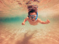 Child swimming underwater with swim mask young boy Stock Photography
