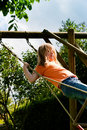 Child on a swing in garden Stock Photo