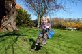 Child swing in garden Stock Photo