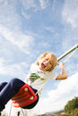Child on a swing laughing the Stock Photo