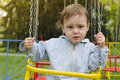Child on swing a portrait of a toddler or boy or girl a chain Stock Photography