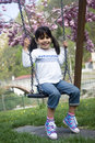 Child on swing young girl playing Stock Photography