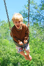 Child Swinging at Park Royalty Free Stock Photo