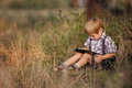 Child with tablet pc outdoors. Royalty Free Stock Photo