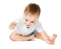 Child takes something on the floor Royalty Free Stock Photo