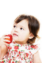 Child tastes apple Royalty Free Stock Images
