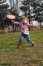 Child throwing frisbee young boy outside Royalty Free Stock Photo