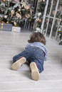 Child toddler crawling to gifts Royalty Free Stock Photo