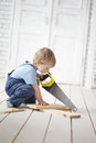 Child with tool work indoors Stock Photo