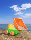 Child Toy Car On The Beach Royalty Free Stock Photo