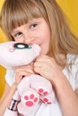 Child with a toy cat Stock Image
