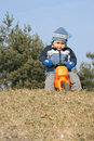 Child on toy motorbike Stock Image