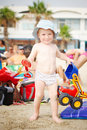 Child with toys on the beach Stock Image