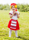 Child in traditional folk clothes on grass Royalty Free Stock Images