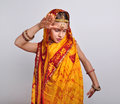 Child in traditional indian clothing and jeweleries dancing portrait of sari Royalty Free Stock Photos