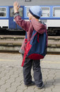 Child at train station with backpacks waving to a back view Royalty Free Stock Image