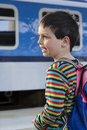 Child at train station boy platform watching passing or leaving Royalty Free Stock Photo