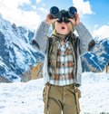 Child travellers looking into the distance through binoculars Royalty Free Stock Photo