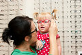 Child trying on eyeglasses Stock Photography