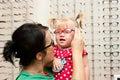 Child trying on eyeglasses Royalty Free Stock Photo