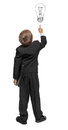 Child in a tuxedo pointing at wall rear view isolated over white Stock Image