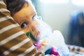 Child under medical treatment nebuliser respiratory therapy Royalty Free Stock Image
