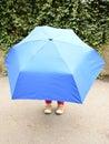 Child under umbrella Royalty Free Stock Photo