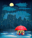 Child under an umbrella in night city. Stock Images