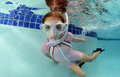 Child underwater in pool young swimming with goggles and snorkel Stock Photography
